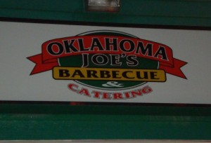 The sign on the outside of Oklahoma Joe's BBQ.  The building is actually a functioning gas station as well.